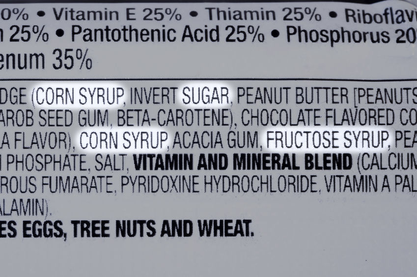34563855 - closeup of ingredients list of granola health bar with forms of sugar highlighted